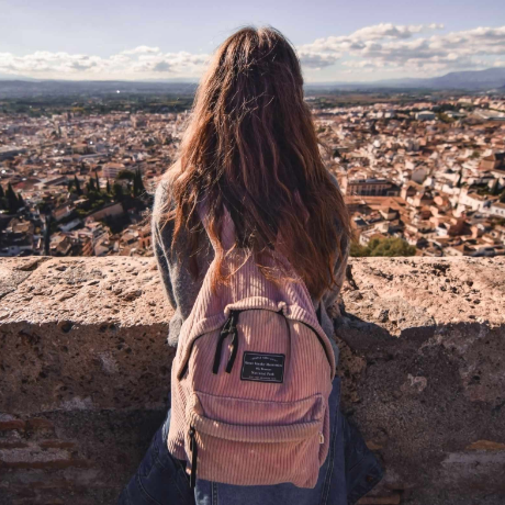 a girl with a panoramic view of a European city