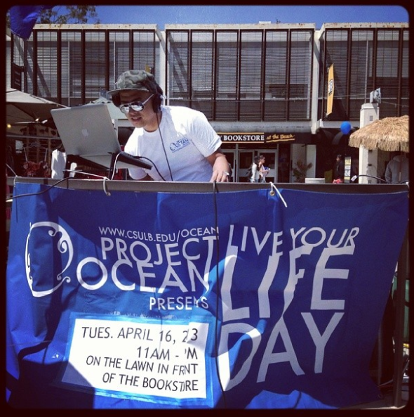 A DJ spinning tunes on Live Your Life Day